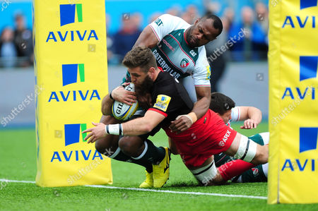 Will Fraser of Saracens scores the opening try of the match