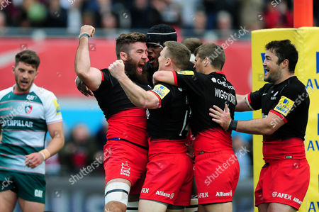 Will Fraser of Saracens celebrates his first half try