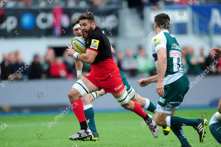 Will Fraser of Saracens runs in the opening try of the match