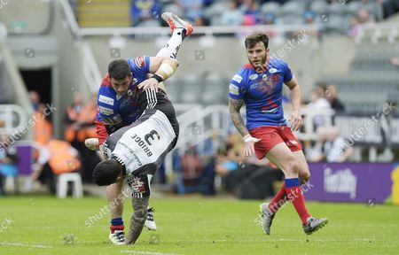 Salford Red Devils' Justin Carney spear tackles Widnes Vikings' Chris Bridge during the First Utility 2016 Super League match between Salford Red Devils and Widnes Vikings During the Dacia Magic Weekend at St James Park, Newcastle, on Saturday the 21st of May 2016