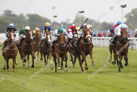 Stock Picture of HARRY HURRICANE and Robert Winston (right) Win the titanbet.co.uk Spring Sprint (Handicap Stakes) for trainer George Baker. In 2nd Kevin Ryan's BOGART ridden by Tom Eaves (yellow/purple) In 3rd Dandy Nichols KIMBERELLA ridden by Royston Ffrench. YORK RACECOURSE