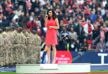 Stock Photo of Singer Karen Harding sings the National Anthem after a technical difficulty meant she missed her cue