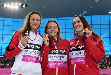 Mie Oe Nielsen of Denmark (Silver) Francesca Halsall of Great Britain (Gold) and Georgia Davies of Great Britain pose with their medals after the Women's 50m Backstroke Final.
