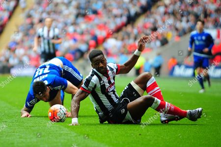 Grimsby Town striker Omar Bogle scrambles to his feet after tangling with FC Halifax Town defender Matthew Brown during the FA Trophy match between Grimsby Town FC and Halifax Town at Wembley Stadium, London