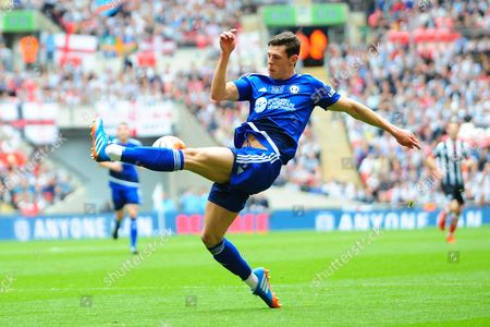 FC Halifax Town defender Matthew Brown clears during the FA Trophy match between Grimsby Town FC and Halifax Town at Wembley Stadium, London