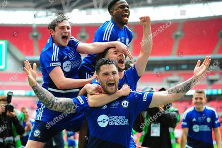 FC Halifax Town defender Matthew Brown leads the celebrations after his team's victory during the FA Trophy match between Grimsby Town FC and Halifax Town at Wembley Stadium, London