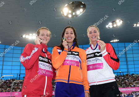 Francesca Halsall of Great Britain (Silver) Ranomi Kromowidjojo of The Netherlands (Gold) and Anna Santamans of France (Bronze) pose with their medals after the Women's 50m Freestyle Final.