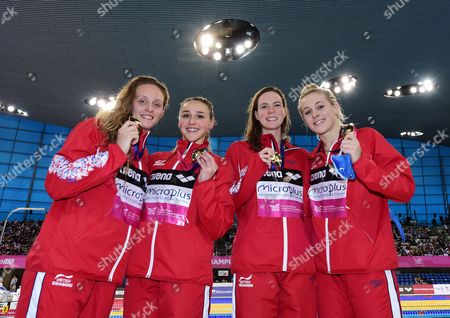 Francesca Halsall, Chloe Tutton, Kathleen Dawson and Siobhan-Marie O'Connor of Great Britain poe with their Gold medals after victory in the Women's 4x100m Medley Relay Final.