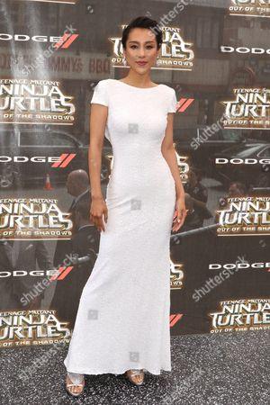 Stock Picture of Jane Wu, wearing a Badgley Mischka dress