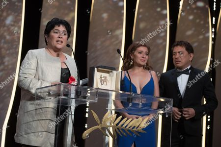 Filipino actress Jaclyn Jose talks on stage after being awarded the Best Actress prize