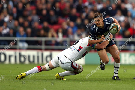 Callum Sheedy of Bristol tries to beat the tackle of Michael Hills (Captain) of Doncaster