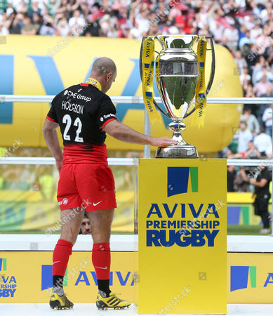 Charlie Hodgson of Saracens touches the trophy
