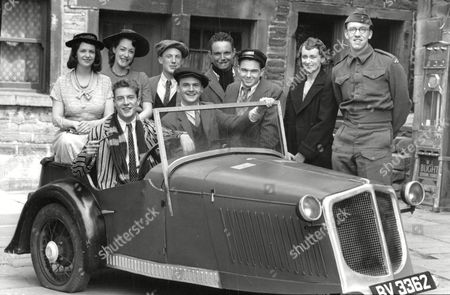 Stock Photo of Cast Of The Tv Programme: First Of The Summer Wine. Paul Mclain (scarf) David Fenwick. Back Row L-r: Sarah Dangerfield Unknown Unknown Paul Wyett Gary Whitaker Helen Patrick Unknown. Box 634 813101524 A.jpg.