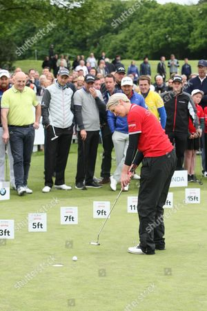 Georgie Bingham, putts in front of Robbie Fowler, Thomas Bjorn, Mike Tindall, Heine Zuell, Keith Wood, Tony McCoy and Graeme McDowell