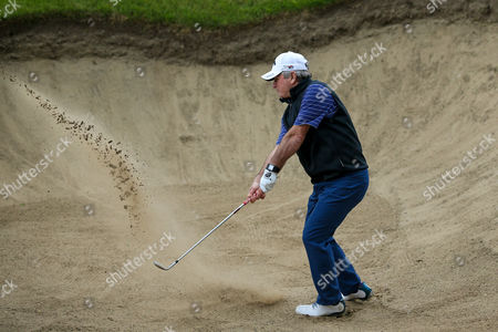 Allan Lamb attempts to get out of a bunker