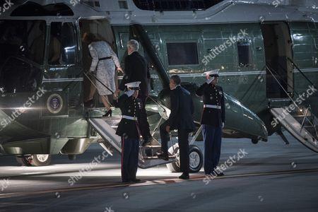 US President Barack Obama (R) escorts US Ambassador to Japan Caroline Kennedy Schlossberg (L) and her husband Edwin Schlossberg (C) to board Marine One