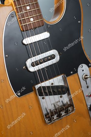 Stock Photo of Detail Of The Pickups On A Vintage 1966 Fender Telecaster Electric Guitar Previously Owned By English Musician Mike Oldfield