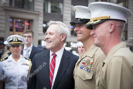 Secretary of the Navy (SECNAV) Ray Mabus poses with US Navy Sailors and Marines at the SelfieWithTheSecNav event at the Armed Forces Recruiting Station in Times Square during Fleet Week NY 2016.
