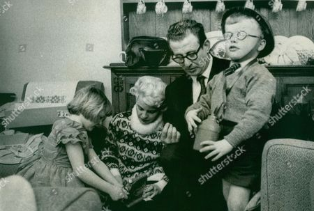 Stock Image of William Beland And His Wife Greta Reunited With Their Children Janet And John Five Years After Leaving Them In A Boarding Kindergarten In Brighton. The Children Were Taken Into Council Care And Only Returned After Brighton's Children's Officer Frederick Miller Issued An Appeal For The Parents. Box 635 114101522 A.jpg.