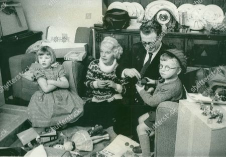Editorial picture of William Beland And His Wife Greta Reunited With Their Children Janet And John Five Years After Leaving Them In A Boarding Kindergarten In Brighton. The Children Were Taken Into Council Care And Only Returned After Brighton's Children's Officer Fred