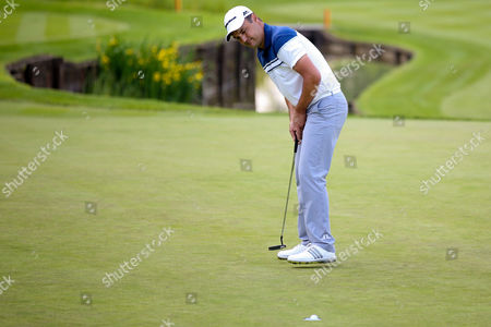golf professional Simon Khan makes his putt on the 18th at the BMW PGA Championship at the Wentworth Club, Virginia Water