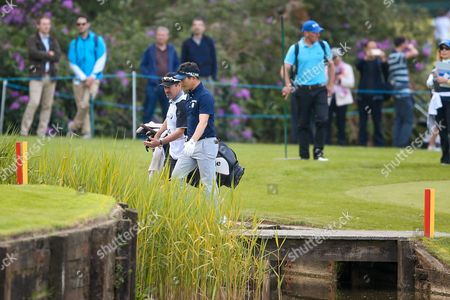 golf professional Y E Yang  crosses the bridge at the 18th at the BMW PGA Championship at the Wentworth Club, Virginia Water