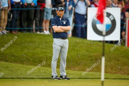 golf professional Y E Yang  contemplates getting out of the bunker on the 18th at the BMW PGA Championship at the Wentworth Club, Virginia Water