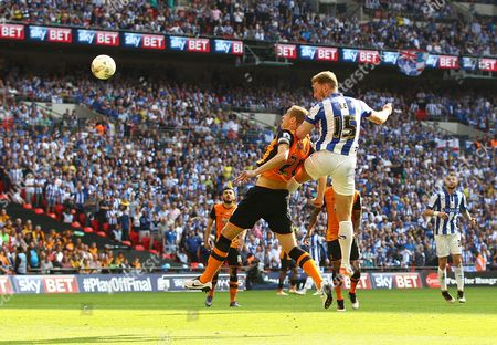 Tom Lees of Sheffield Wednesday heads at the goal under pressure from Michael Dawson of Hull   during the Sky Bet Championship  Play-offs Final match between  Hull City and Sheffield Wednesday  played at Wembley Stadium  , London on 28th May 2016