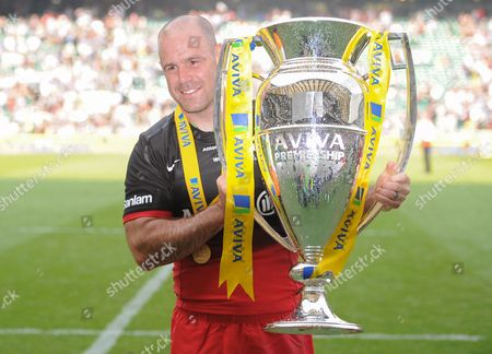 Charlie Hodgson of Saracens celebrates with the Aviva Premiership Rugby Trophy during the Aviva Premiership Rugby Final match between Saracens and Exeter Chiefs played at Twickenham Stadium, London on May 28th 2016