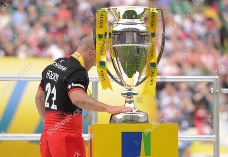 Charlie Hodgson of Saracens places his hand on the trophy after collecting his medal during the Aviva Premiership Rugby Final match between Saracens and Exeter Chiefs played at Twickenham Stadium, London on May 28th 2016