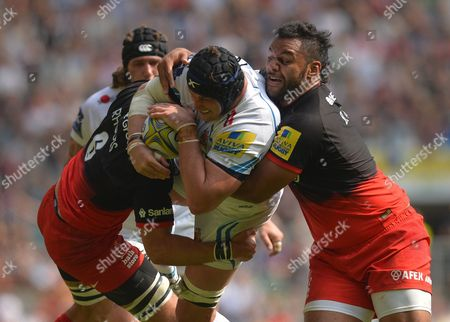 Mitch Lees of Exeter Chiefs is tackled by Michael Rhodes and Billy Vunipola of Saracens during the Aviva Premiership Rugby Final match between Saracens and Exeter Chiefs played at Twickenham Stadium, London on May 28th 2016