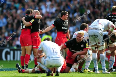 Charlie Hodgson of Saracens celebrates at the final whistle with team-mate Marcelo Bosch