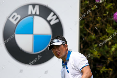 Korean golf professional Y E Yang  apprehensively looks for his ball during the BMW PGA Championship at the Wentworth Club, Virginia Water