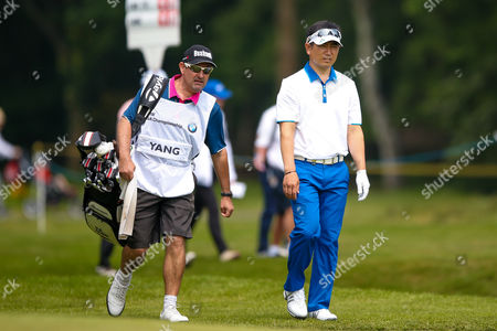 Korean golf professional Y E Yang walks onto the 5th green during the BMW PGA Championship at the Wentworth Club, Virginia Water