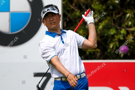 Korean golf professional Y E Yang looks to lose his club while teeing off at the 7th during the BMW PGA Championship at the Wentworth Club, Virginia Water