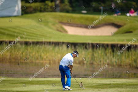 Korean golf professional Y E Yang plays onto the 8th green during the BMW PGA Championship at the Wentworth Club, Virginia Water