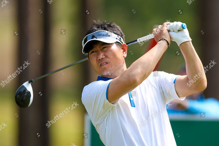 Korean golf professional Y E Yang  tees off on the 11th during the BMW PGA Championship at the Wentworth Club, Virginia Water