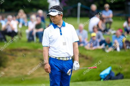 Korean golf professional Y E Yang just misses a putt during the BMW PGA Championship at the Wentworth Club, Virginia Water