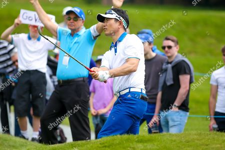 Korean golf professional Y E Yang  chips onto the green during the BMW PGA Championship at the Wentworth Club, Virginia Water