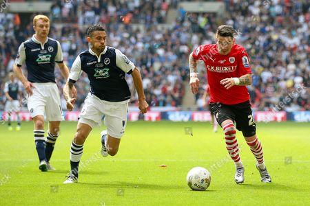 Millwall FC midfielder Carlos Edwards (4)  tries to stop Barnsley midfielder Adam Hammill (20)  during the Sky Bet League 1 play off final match between Barnsley and Millwall at Wembley Stadium, London
