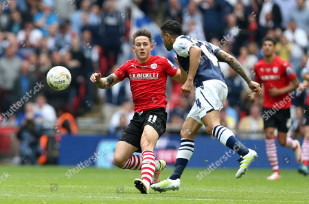 Josh Brownhill of Barnsley chases down Carlos Edwards of Millwall