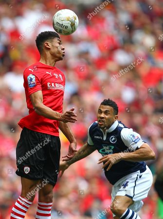 Stock Photo of Ashley Fletcher of Barnsley and Carlos Edwards of Millwall   during the Sky Bet League 1  Play-off Final match between  Barnsley FC and Millwall  played at Wembley Stadium  , London on 29th May 2016