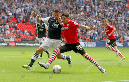 Stock Picture of Adam Hammill of Barnsley and Carlos Edwards of Millwall.