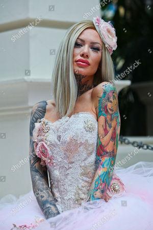 Modal Becky Holt wearing wedding dress by Philippa Lusty