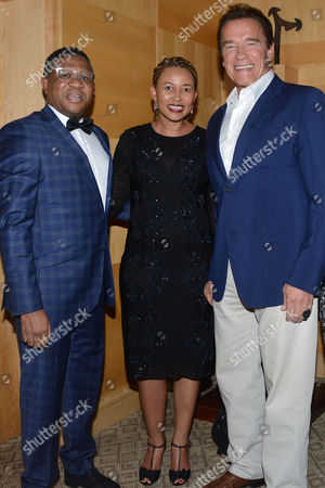 Stock Image of Fikile Mbalula, his wife Nozuko Mbalula and Arnold Schwarzenegger