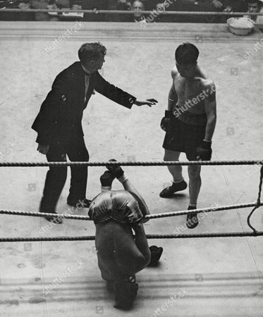 Boxing: Jack Lord V Jake Kilrain. Lord Is Knocked Through The Ropes In The Ninth Round. Box 640 718111529 A.jpg.