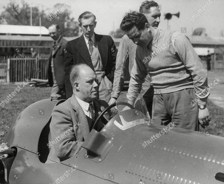 Geoff Taylor In The Seat Of His Alta Car. He Is The Maker Of The Car While Joe Kelly The Racing Driver Looks On At Silverstone. Box 642 52011157 A.jpg.