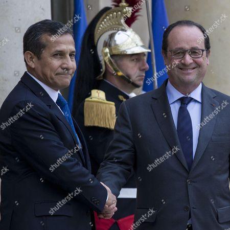 French President Francois Hollande welcomes Peru's President Ollanta Humala