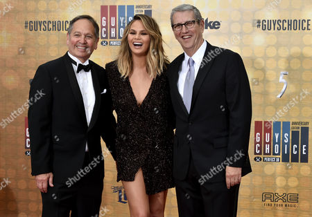 Stock Picture of Kevin Kay, Christine Teigen and Doug Herzog