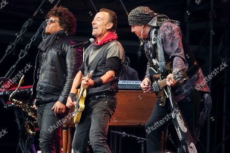 Bruce Springsteen and Steven Van Zandt (right) and Jake Clemons (left) of the E Street Band performing